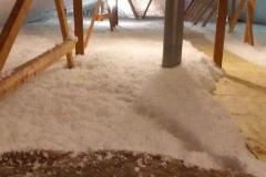 Fiberglass-insulation-blown-in-an-attic