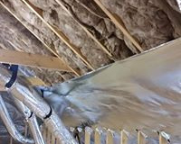 Radiant-barrier-and-fiberglass-insulation-installed-on-roof-decking
